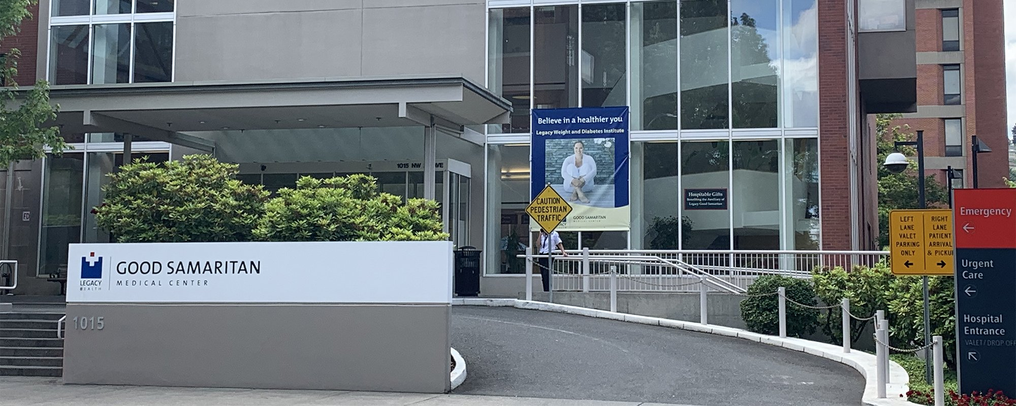 Front of hospital with Legacy Health sign.